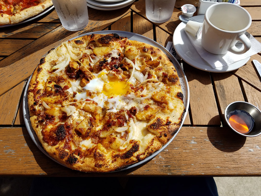 Breakfast pizza with sunny side up egg