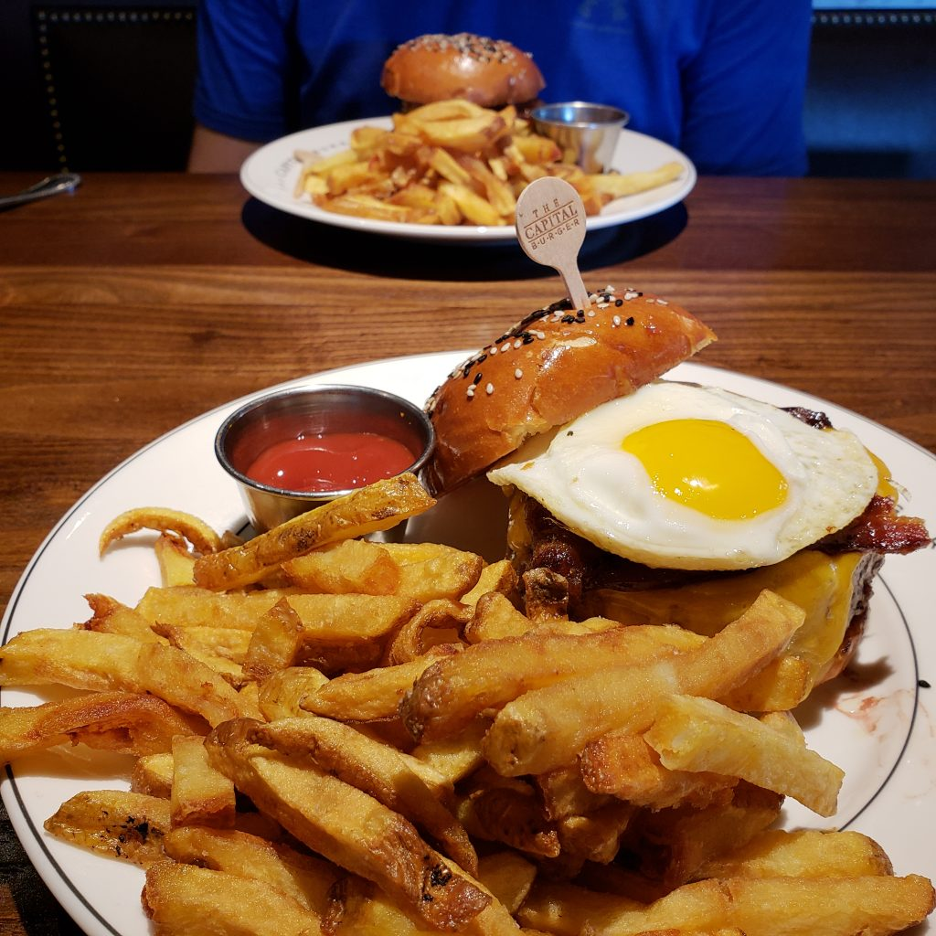 Cheeseburger with an egg and fries