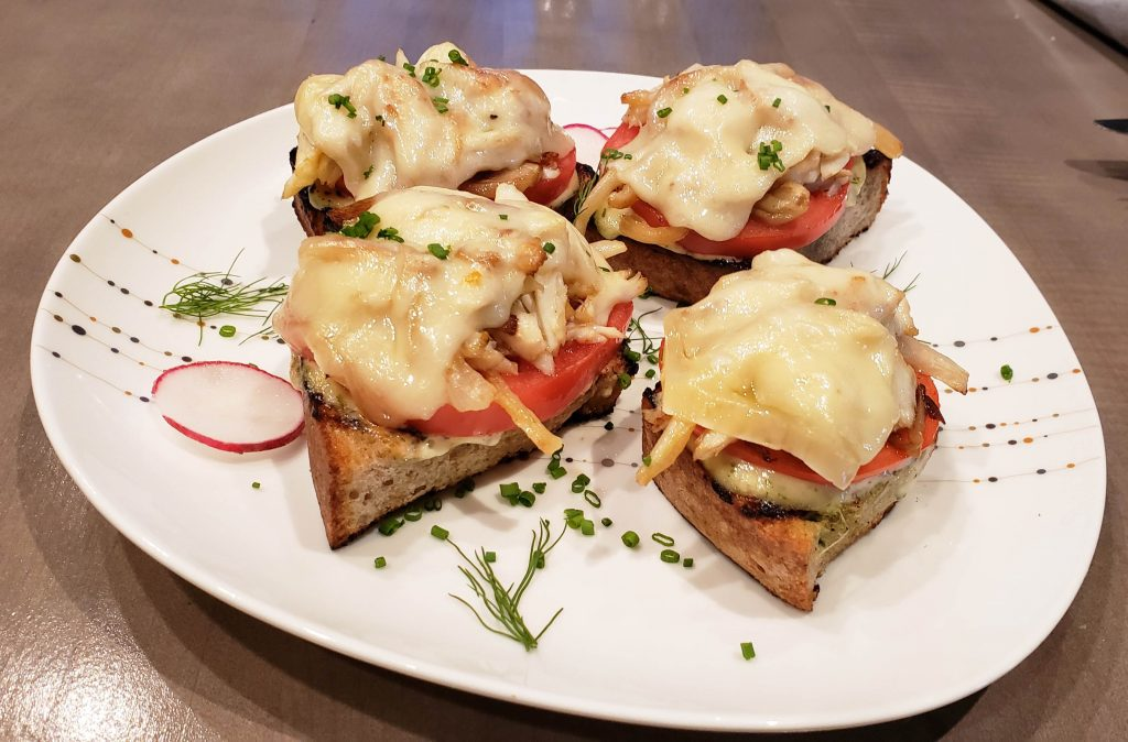 Crab and tomato on bread