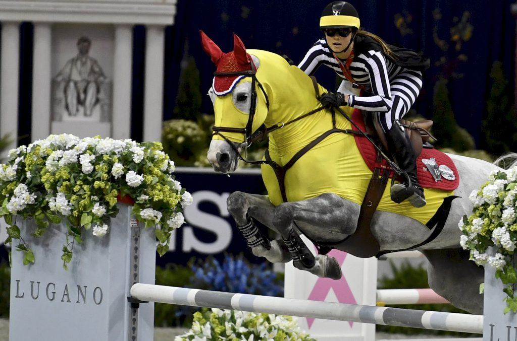 Horse jumping in yellow costume