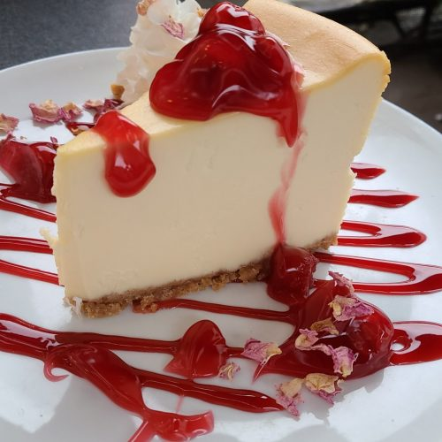 Cheesecake with cherry drizzle